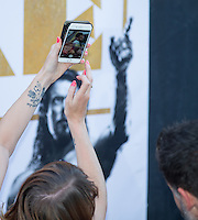 A member of the crowd holds up her phone to capture Joe Manganiello as he poses for selfies at The Magic Mike XXL European Film Premiere at Vue, Leicester Square, London, England on 28 June 2015. Photo by Andy Rowland.