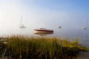 Sailboats in Lake Massabesic in Auburn, New Hampshire on a foggy morning. Located in Manchester and Auburn, this lake covers over 2,500 acres, and it is the drinking water supply for the Manchester area.