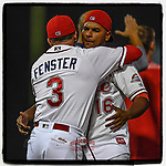 Manager Darren Fenster (3) of the Greenville Drive embraces catcher Roldani Baldwin (16) after winning Game 3 of the South Atlantic League Southern Division Playoff against the Charleston RiverDogs on Saturday, September 9, 2017, at Fluor Field at the West End in Greenville, South Carolina. Greenville won, 5-0, winning the division championship two games to one. (Tom Priddy/Four Seam Images)
