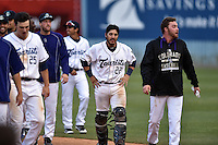 Asheville Tourists celebrate Yonathan Daza's  walk off single after game one of a double header against the Kannapolis Intimidators at McCormick Field on May 21, 2016 in Asheville, North Carolina. The Tourists defeated the Intimidators in game one 3-2. (Tony Farlow/Four Seam Images)