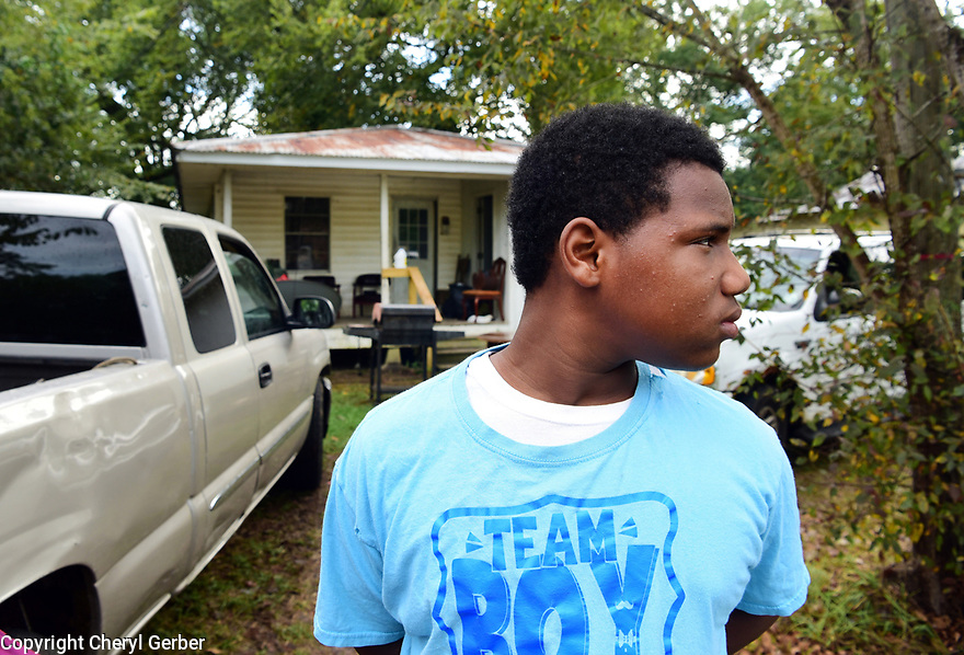 Isaac Friels, outside his grandmother's home, just started seventh grade at Marksville High School, Marksville, La., Sept. 17, 2017.