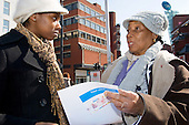 A local resident talks to a staff member at the launch of Homes for Haringey Resident Involvement Agreement; Wood Green, 2007.