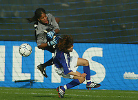 LaKeysia Beene keeps her eye on the ball after making a save against Japan's Mio Otani during a scoreless match.in San Diego, Calif.,  January 12, 2003.