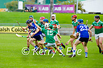St Brendan's Padraig Kearney breaks the tackle from  Crotta players in the County Senior Hurling Championship quarter final