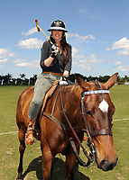 WEST PALM BEACH, FL - MARCH 14:  Kourtney Kardashian and Scott Disick with their young son Mason Dash Disick in tow take a polo lesson with top ranked american polo player Nic Roldan. The couple was joined by sister Khloe Kardashian. The kardashian clan had a great afternoon, riding horses and joking around while they sipped champagne at the International polo club palm beach on March 14, 2010 in Wellington, Florida.<br /> <br /> People:  Khloe Kardashian