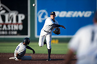 Everett AquaSox shortstop Ryne Ogren (16) makes a throw to first base for a double play as Angel Solarte (9) slides into second base during a Northwest League game against the Tri-City Dust Devils at Everett Memorial Stadium on September 3, 2018 in Everett, Washington. The Everett AquaSox defeated the Tri-City Dust Devils by a score of 8-3. (Zachary Lucy/Four Seam Images)