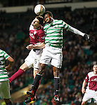 Efe Ambrose and Stewart Malcom compete for a high ball