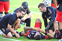 WASHINGTON, DC - NOVEMBER 8: Gelmin Rivas #20 of D.C. United get attended by team staff after a hard tackle during a game between Montreal Impact and D.C. United at Audi Field on November 8, 2020 in Washington, DC.