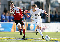 Scott Caldwell #15 of the University of Akron pulls away from Paolo DelPiccolo #3 of the University of Louisville during the 2010 College Cup final at Harder Stadium, on December 12 2010, in Santa Barbara, California.Akron champions, 1-0.
