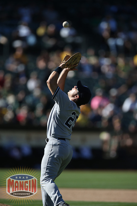 OAKLAND, CA - JUNE 13:  Mark Teixeira #25 of the New York Yankees catches a pop up against the Oakland Athletics during the game at O.co Coliseum on Thursday June 13, 2013 in Oakland, California. Photo by Brad Mangin