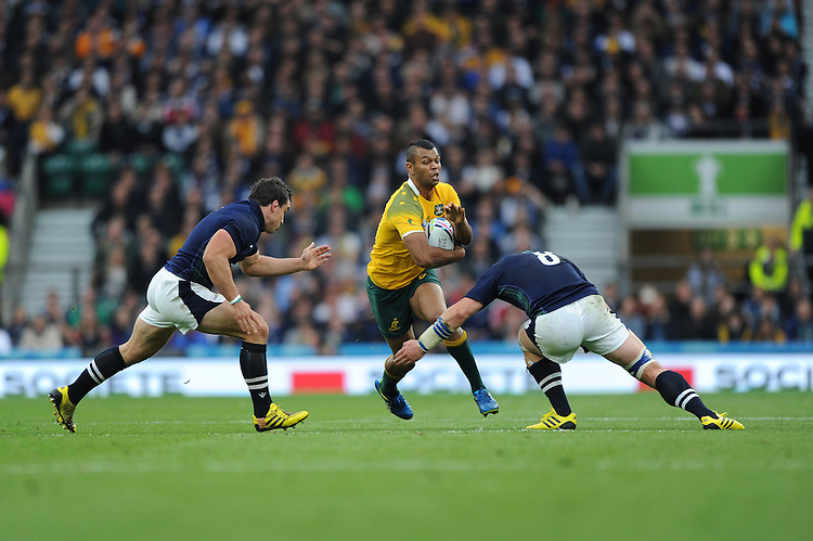 Kurtley Beale of Australia is tackled by John Hardie and Dave Denton of Scotland during the Quarter Final of the Rugby World Cup 2015 between Australia and Scotland - 18/10/2015 - Twickenham Stadium, London<br /> Mandatory Credit: Rob Munro/Stewart Communications