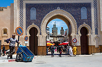 Fes, Morocco.  Bab Boujeloud, Entrance to Fes El-Bali, the Old City.  The minaret of the Bou Inania medersa is in the background, on left.