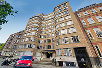 BNPS.co.uk (01202) 558833. <br /> Pic: OrlandoReid/BNPS<br /> <br /> A flat in a ten-storey Art Deco mansion block that was the fictional home of TV detective Hercule Poirot has gone up for rent for £1,950 a month.<br /> <br /> Grade II listed Florin Court in East London was used for filming the long-running ITV series about Agatha Christie's iconic detective.<br /> <br /> The one-bedroom ground floor flat includes a double bedroom, an open plan reception room and kitchen, and a study or home office and<br /> a marble-tiled family bathroom.<br /> <br /> The exterior of the building has strong Art Deco motifs, many of which were used in the filming of Poirot, for 24 years, from 1989 to 2013.