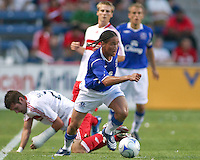 Everton midfielder Steven Pienaar (20) wins a ball in midfield.  The Chicago Fire defeated English Premier League Team Everton FC 2-0 in a friendly match at Toyota Park in Bridgeview, IL, on July 30, 2008.