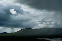 Rain showers move over the tundra along the Denali Highway, Alaska.