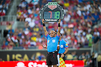 Orlando, Florida - Saturday, June 04, 2016: Yadel Martinez (fourth official) displays the substitution board during a Group A Copa America Centenario match between Costa Rica and Paraguay at Camping World Stadium.