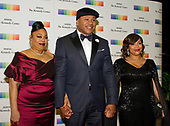 LL COOL J, center, arrives with his Mother, Andrea Smith, left and his wife, Simone Smith, right, for the formal Artist's Dinner honoring the recipients of the 40th Annual Kennedy Center Honors hosted by United States Secretary of State Rex Tillerson at the US Department of State in Washington, D.C. on Saturday, December 2, 2017. The 2017 honorees are: American dancer and choreographer Carmen de Lavallade; Cuban American singer-songwriter and actress Gloria Estefan; American hip hop artist and entertainment icon LL COOL J; American television writer and producer Norman Lear; and American musician and record producer Lionel Richie.  <br /> Credit: Ron Sachs / Pool via CNP
