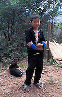 Laos, Udom Xai Province, Na Mor..Hmong boy...Photo by Kees Metselaar, 2003