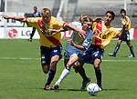 UNAM Pumas' midfielder Leandro Augusto (C)  fights for the ball with Morelia Monarcas' Cristian Nasuti (L) and Fernando Arce (R) during the soccer match in the University Stadium, March 12, 2006. UNAM Pumas defeated Morelia 1-0. Photo by Javier Rodriguez