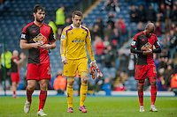 BLACKBURN, ENGLAND - JANUARY 24:  ( L-R )  Jordi Amat of Swansea City Lukasz Fabianski of Swansea City and Dwight Tiendalli of Swansea City leave the field with their heads down  during the FA Cup Fourth Round match between Blackburn Rovers and Swansea City at Ewood park on January 24, 2015 in Blackburn, England.  (Photo by Athena Pictures/Getty Images)