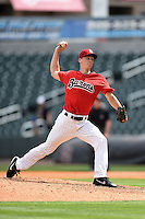 Birmingham Barons pitcher Cody Winiarski (35) delivers a pitch during a game against the Tennessee Smokies on April 21, 2014 at Regions Field in Birmingham, Alabama.  Tennessee defeated Birmingham 10-5.  (Mike Janes/Four Seam Images)