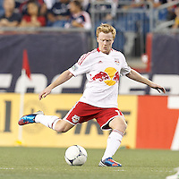 New York Red Bulls midfielder Dax McCarty (11) passes the ball. In a Major League Soccer (MLS) match, New England Revolution defeated New York Red Bulls, 2-0, at Gillette Stadium on July 8, 2012.