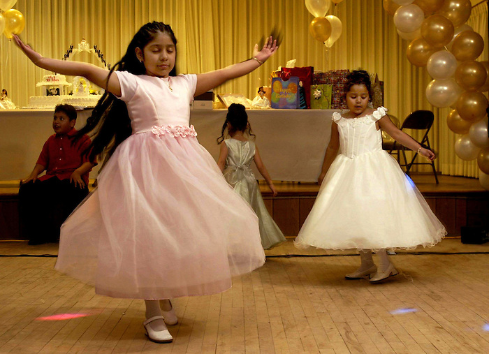 """""""Sweet 15"""".Two younger cousins of Angelica, imagine their own Quinceanera and dance like princesses..Summary.A Quinceanera or Sweet 15 party is a Latina tradition which resembles a lavish wedding. It is part prom, part debutante ball, and  part bar mitzvah, but distinctly latin. It?s a young lady?s wedding, but without the downside of having to have a husband."""