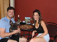 Drew Gorton and Katelynn Zoellner, with Cooper, enjoy Dog Days of Summer. <br /> (NWA Democrat-Gazette/Carin Schoppmeyer)