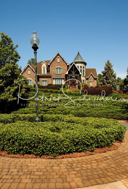 A home in the Ballantyne Country Club neighborhood near Charlotte, NC. Ballantyne, a suburb of Charlotte NC, is located near the South Carolina border. The 2,000-acre mixed-use development was created by land developer Howard C. Smokey Bissell.