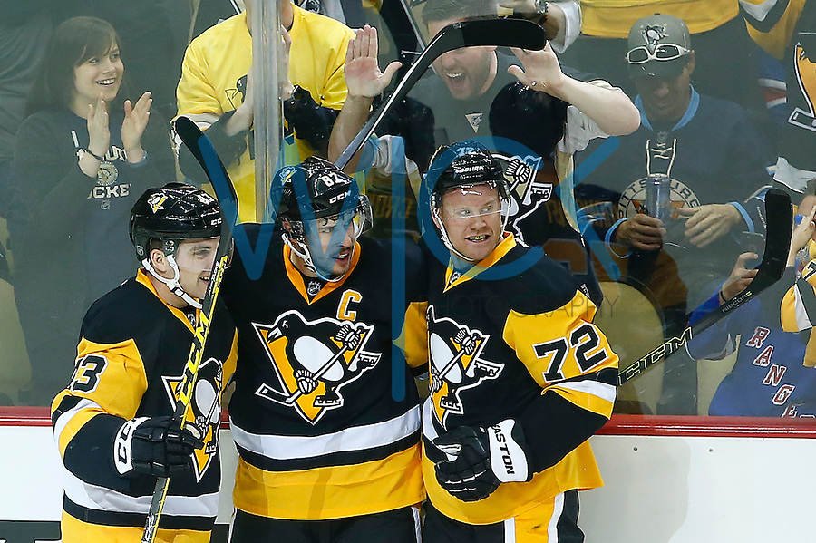 Sidney Crosby #87 of the Pittsburgh Penguins is congratulated by teammates Conor Sheary #43 and Patric Hornqvist #72 of the Pittsburgh Penguins after scoring a goal against the New York Rangers during game one of the first round of the Stanley Cup Playoffs at Consol Energy Center in Pittsburgh, Pennsylvania on April 13, 2016. (Photo by Jared Wickerham / DKPS)