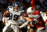 Nov. 6, 2005; Tempe, AZ, USA; Wide receiver (89) Jerheme Urban of the Seattle Seahawks is tackled by safety (34) Robert Griffith of the Arizona Cardinals at Sun Devil Stadium. Mandatory Credit: Mark J. Rebilas
