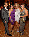 Rudy Festari, Yvonne Stern, Susan Plank and Debbie Festari at the Una Notte in Italia dinner and fashion show at the InterContinental Hotel Friday Nov. 07, 2008. (Dave Rossman/For the Chronicle)