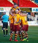 Motherwell celebrate going 2 goals up through a Kevin Holt OG
