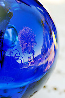 Detail of astrologer Sarah Bartlett's crystal ball showing view of her garden, Mandelieu-la-Napoule, France, 03 May 2012