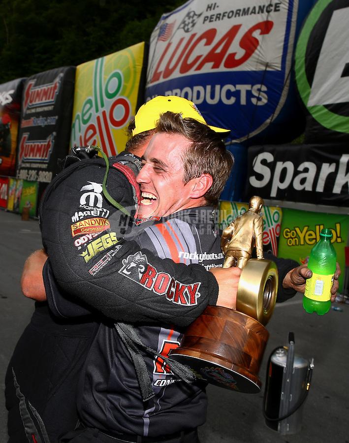 Jun 21, 2015; Bristol, TN, USA; NHRA funny car driver Matt Hagan celebrates with crew member Alex Conaway after winning the Thunder Valley Nationals at Bristol Dragway. Mandatory Credit: Mark J. Rebilas-