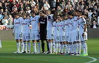 Pictured: Swansea players observe a minute's silence  before kick off in memory of Wales football manager Gary Speed who has died. Saturday 27 November 2011<br />