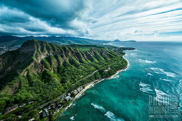 An aerial view of variegated clouds over southeastern O'ahu, from Diamond Head Crater to Hawai'i Kai's Koko Crater and Koko Head, Honolulu, O'ahu.