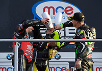 Winner Josh Brookes of Anvil Hire Tag Racing on the podium with second place Jason O'Halloran of Honda Racing (Left) and Third place James Ellison of McAMS Yamaha (Right) gets his boot filled with Champagne after the Final of the MCE British Superbikes in Association with Pirelli round 12 2017 - BRANDS HATCH (GP) at Brands Hatch, Longfield, England on 15 October 2017. Photo by Alan  Stanford / PRiME Media Images.