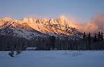 A landscape view of the sunrise alpenglow on the Tetons in grand Teton National Park, Wyoming.
