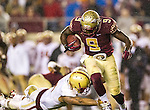Boston College defensive back Dominique Williams misses a tackle of Florida State running back Karlos Williams as he heads upfield in the second half of an NCAA college football game in Tallahassee, Fla., Saturday, Nov. 22, 2014.  Florida State defeated Boston College 20-17.  (AP Photo/Mark Wallheiser)