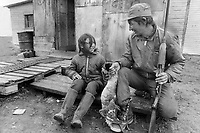 1972 FILE PHOTO - ARCHIVES -<br /> <br /> Cree Trapper Philip Cox; shown at home with daughter; Evelyn; 8; is one of the few Indians who still rely on trap lines for most of their income. Cox's line is on the site of a proposed hydro dam and airstrip; part of a giant plan to develop the James Bay area of Quebec.<br /> <br /> PHOTO :  Keith  BEATY  - Toronto Star Archives - AQP