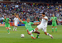 Clint Dempsey of USA and Madjid Bougherra of Algeria. USA defeated Algeria 1-0 in stoppage time in the 2010 FIFA World Cup at Loftus Versfeld Stadium in Pretoria, Sourth Africa, on June 23th, 2010.