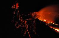 Male tourist looking into Kupianaha vent at Kilauea volcano, Hawaii volcanoes national park