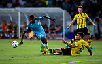 Manchester City striker Kelechi Iheanacho (l) trips up with Borussia Dortmund defender Sokratis Papastathopoulos (r) during the match between Manchester City FC during their 2016 International Champions Cup China match at the Shenzhen Stadium on 28 July 2016 in Shenzhen, China. Photo by Marcio Machado / Power Sport Images