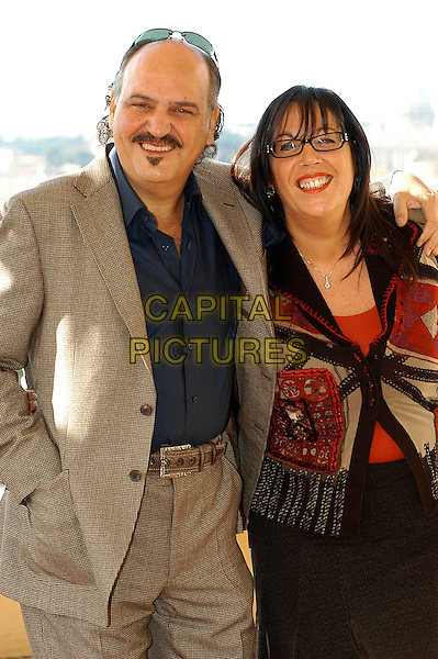 "CLAUDIO FRAGASSO & ROSSELLA DRUDI.Photocall for ""Milano-Palermo: il ritorno"", Rome, Italy..November 15th, 2007.half length beige suit jacket red pattern top glasses.CAP/CAV.©Luca Cavallari/Capital Pictures."