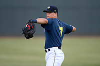 First baseman Brian Sharp (7) of the Columbia Fireflies warms up before a game against the Rome Braves on Tuesday, June 4, 2019, at Segra Park in Columbia, South Carolina. Columbia won, 3-2. (Tom Priddy/Four Seam Images)