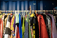 Outfits used in magic performances hang on a rack at the Cape Town College of Magic.