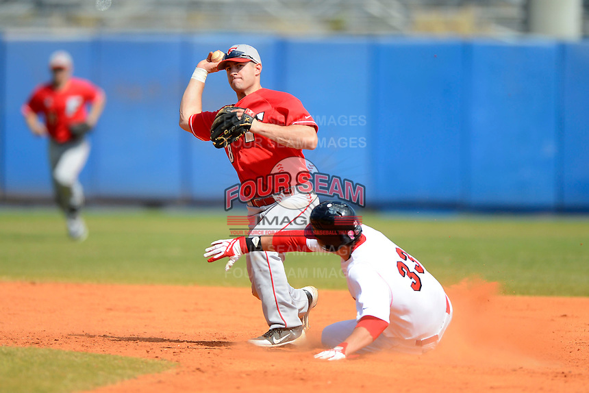 Fairfield Stags second baseman Rob LoPinto #8 attempts to turn a double play as Eric Aguilera #33 slides in during a game against the Illinois State Redbirds at Chain of Lakes Stadium on March 10, 2013 in Winter Haven, Florida.  Illinois State defeated Fairfield 4-2.  (Mike Janes/Four Seam Images)