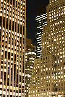 AVAILABLE FROM JEFF AS A FINE ART PRINT.<br /> <br /> AVAILABLE FROM PLAINPICTURE FOR COMMERCIAL AND EDITORIAL LICENSING.  Please go to www.plainpicture.com and search for image # p5690011. <br /> <br /> Office Buildings at Night with Illuminated Windows, 5th Avenue at 59th Street, Midtown Manhattan, New York City, New York State, USA