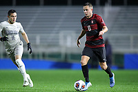 CARY, NC - DECEMBER 13: Jared Gilbey #8 of Stanford University is followed by Jack Beer #11 of Georgetown University during a game between Stanford and Georgetown at Sahlen's Stadium at WakeMed Soccer Park on December 13, 2019 in Cary, North Carolina.
